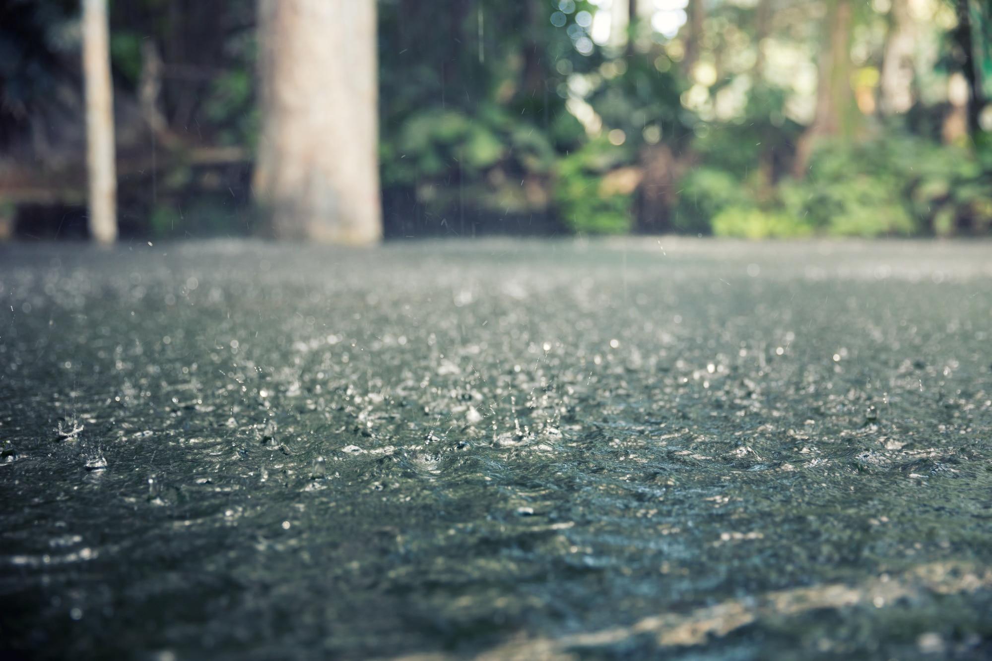 Rain Drops on A Road Closeup